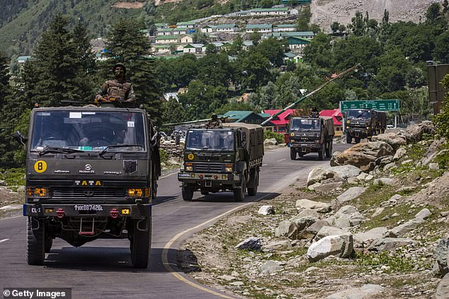 Indian army convoy rolls along highway bordering China in June following deadly confrontation at long-contested border