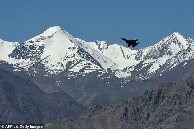 An Indian fighter jet flies over mountains near the border with China earlier this year