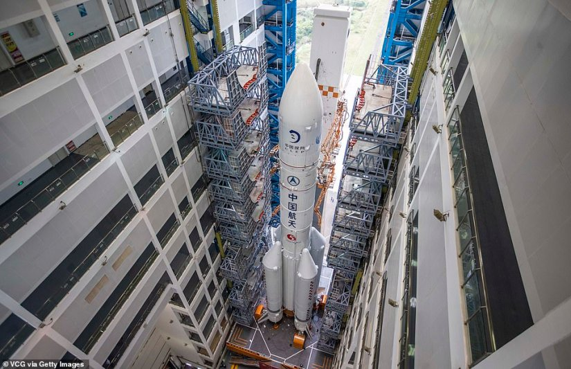 The fifth Long March-5 rocket, with China's new lunar probe Chang'e-5 on top, is ready to be transferred to the launch area
