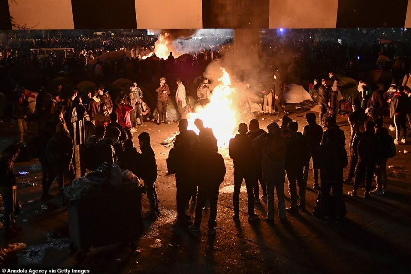 Various bonfires are seen throughout the giant migrant camp