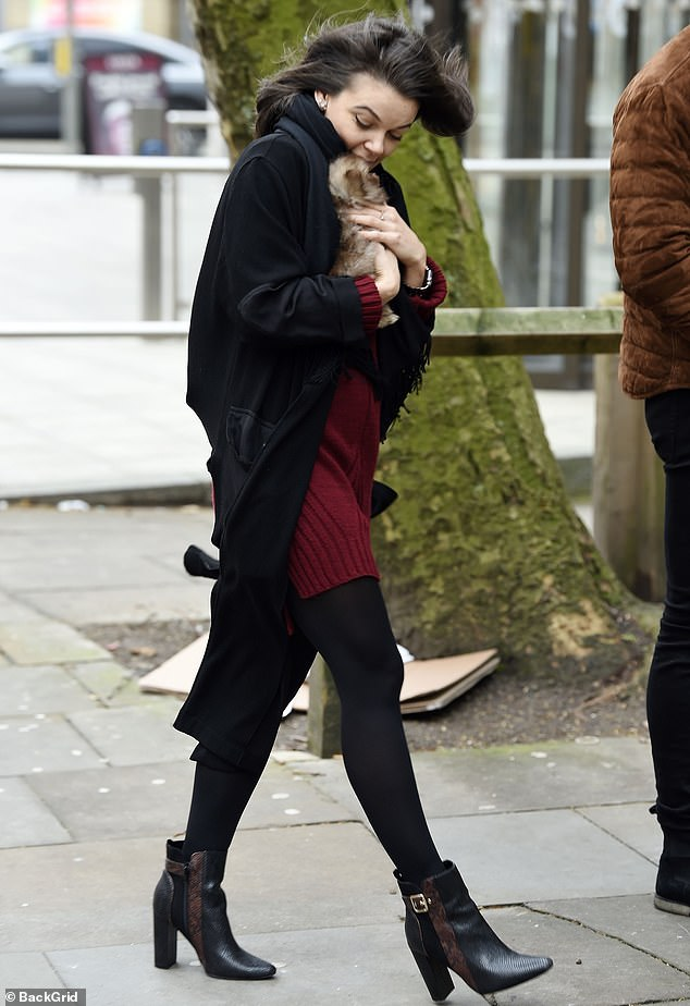 Autumnal chic:Faye cut a casual figure in a crimson knit dress and a cardigan which she paired with black tights