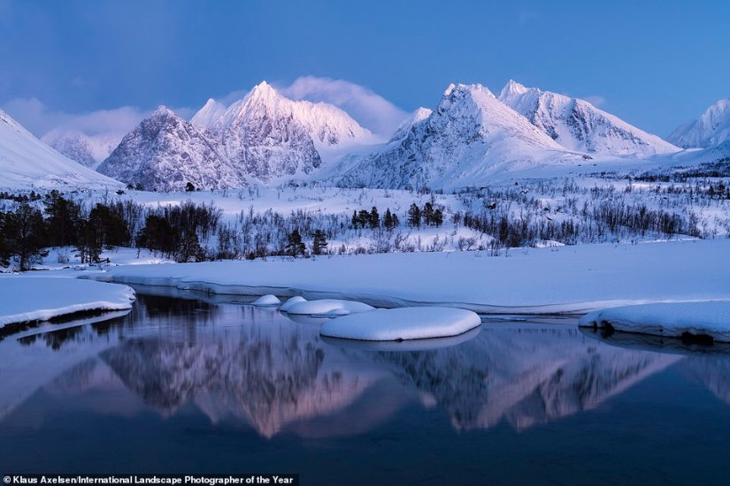 Photographer Klaus Axelsen is behind this beautiful image of the Lyngen Alps in Troms, Northern Norway. He called the photo Blue Hour Scenery