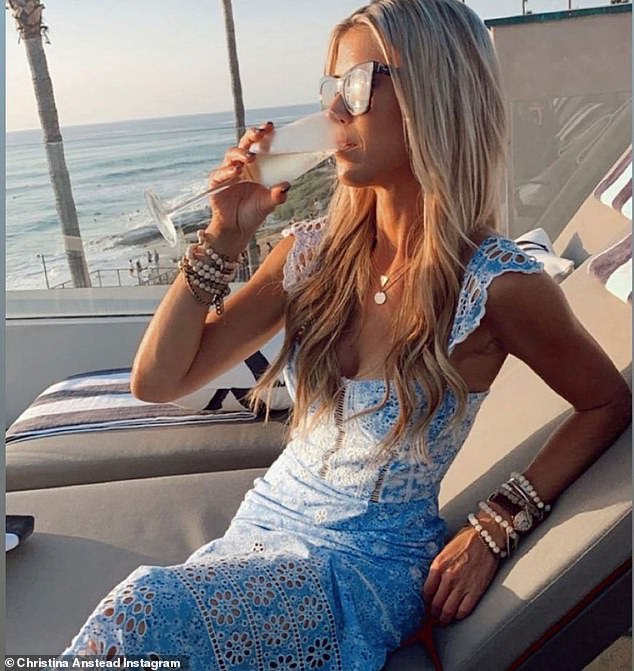 Christina Anstead sips wine at her beachfront home as she reflects on her crazy year