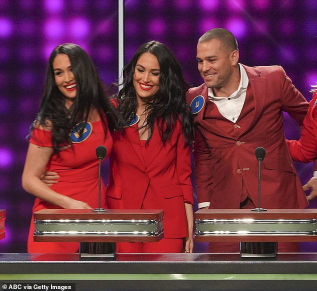 Family feud: The Bella twins with their brother JJ on an episode of Celebrity Family Feud