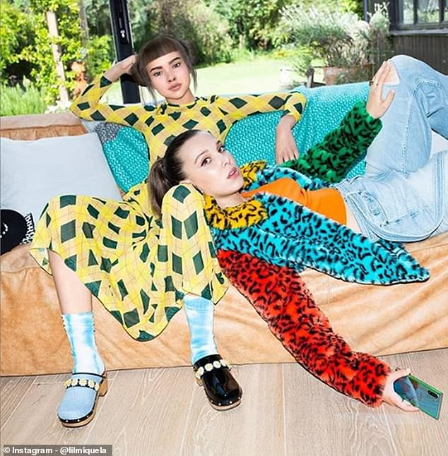She's the kind of person every teenage girl would love to have as a best friend. As a result, millions of young people look to Miquela, pictured with actress Millie Bobby Brown, for advice on what to buy, how to dress and even what to think