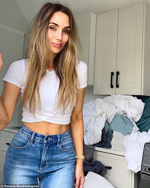 Snezana Wood flaunts her figure and says she's like most mums 'hiding in the laundry' from her kids