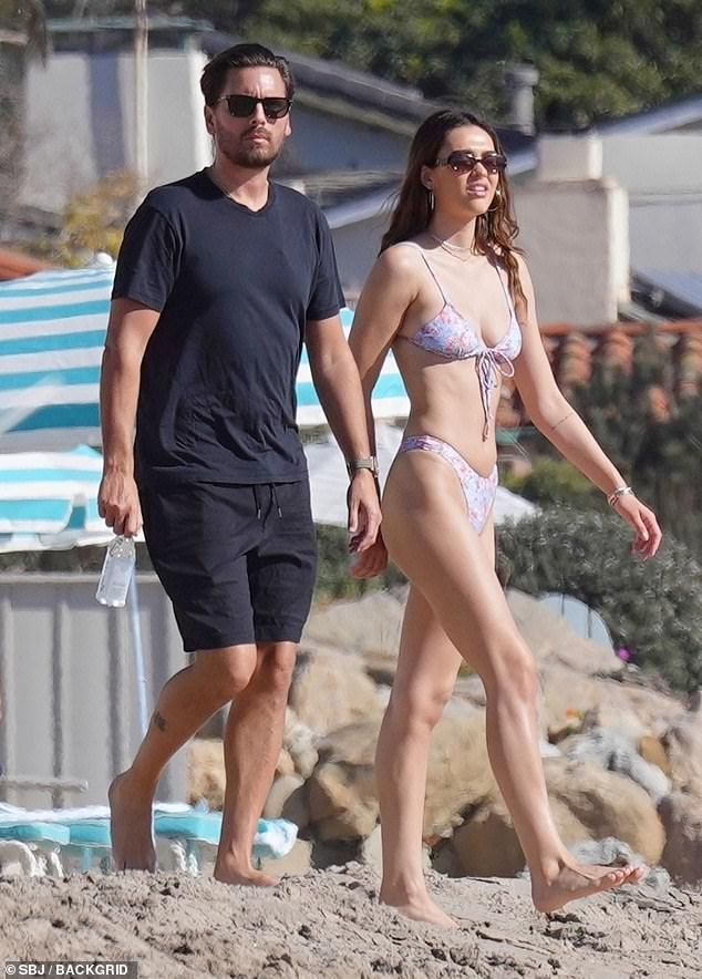 Bikini Babe: Amelia's sexy two-piece floral print consisted of a pair of high-leg stockings and a tie-front top that allowed her to show off her enviable cut figure