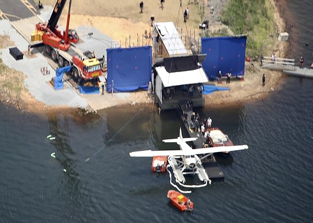 Production: The images show a large crane and a seaplane situated at the end of the port