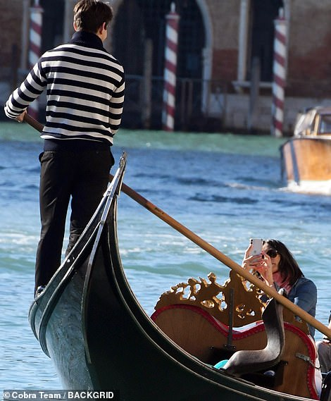 Create memories!  Mel made sure she documented the moment as she took a photo of Riccardo driving his gondola