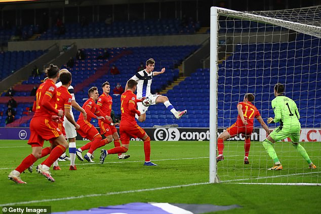 Daniel O'Shaughnessy of Finland with volleyed effort during the first half of Nations League tie