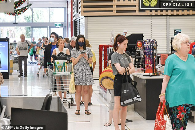 Adelaide shoppers were forced to wait in long queues (pictured) to enter the supermarkets  on Wednesday