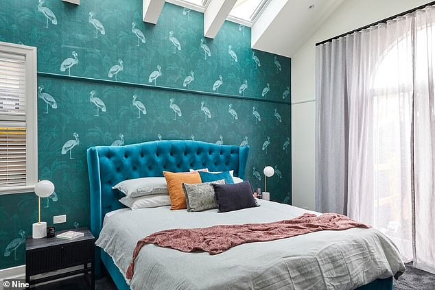 Eye-catching: The master bedroom impressed the judges, thanks to its quirky bird wall paper and plush blue velvet bedhead