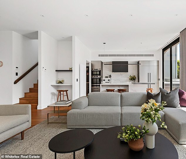 Spacious: On the first floor, the hallway opens to a large, open plan family room that combines the sleek and modern kitchen, with the dining and family room