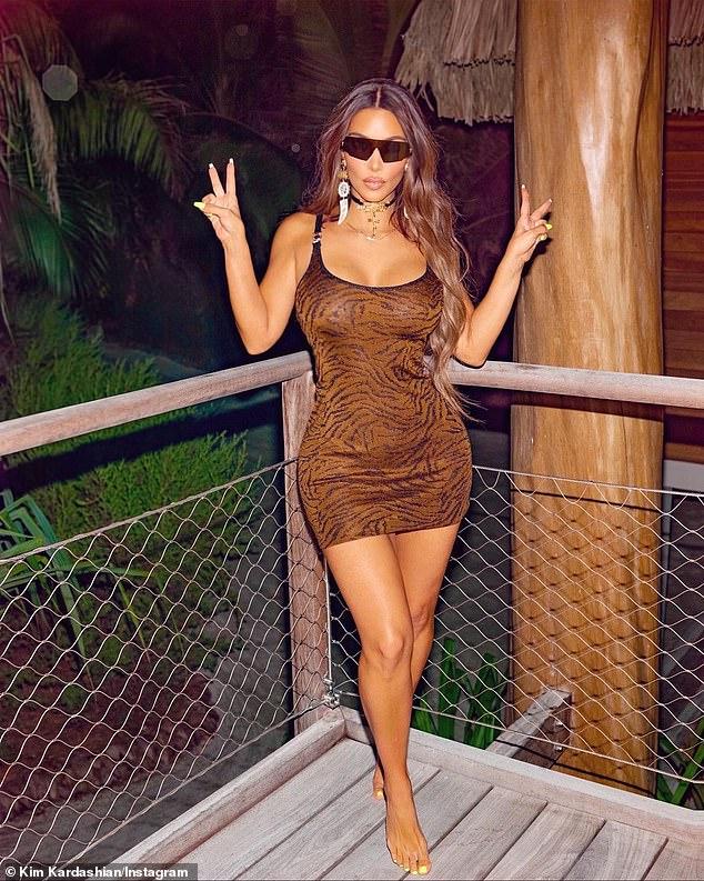 Kim Kardashian rocks Versace mini-dress in yet ANOTHER snap from her M birthday getaway to Tahiti
