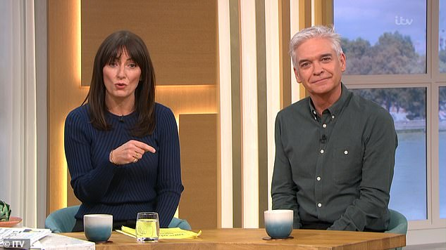 Complementing each other: The dynamic duo got on like a house on fair, with TV star Davina looking radiant in a navy jumper, while Dancing On Ice's Phillip cut a sharp figure in a dark shirt