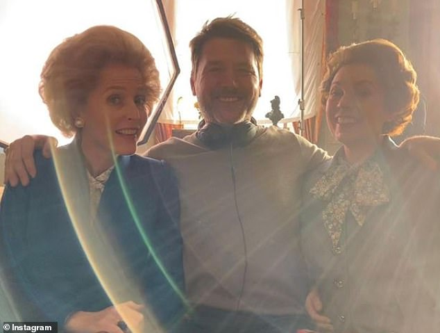 Pally: A crew member poses with Gillian and Olivia between takes