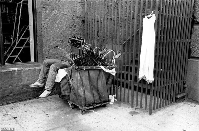 This photograph was taken at the (no longer existent) flea markets around Astor Place in the 1980s. 'It was kind of like an unorganized spontaneous flea market every day. And so that guy was probably relaxing in his bin full of extra stuff.' he said. 'I didn't wake him, I just took the picture and moved on'