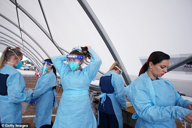 The affected samples were found at a plant in Kincumber which serves Gosford on Monday (pictured: health workers in protective gear at the Bondi testing clinic in Sydney)