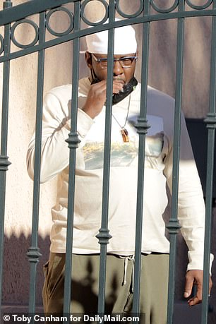 Grief-stricken Bobby Brown was seen Thursday afternoon for the first time since the tragic death of his 28-year-old son.  The music legend looked grim as he spoke with police officers at the entrance to the apartment complex where Bobby Jr. died on Wednesday.