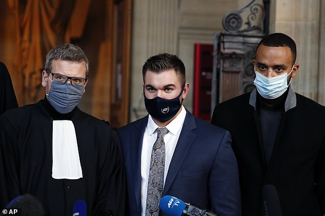 Alek Skarlatos (centre), Anthony Sadler (right), who helped foil the attempted terror attack on the Amsterdam to Paris train with US airman Spencer Stone, stand with their lawyer (left) to talk to the pressduring the Thalys attack trial at the Paris courthouse today