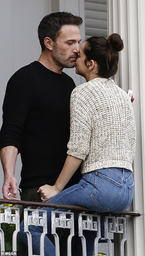 Tender: The 48-year-old actor showered Ana with kisses as they enjoyed a break between scenes