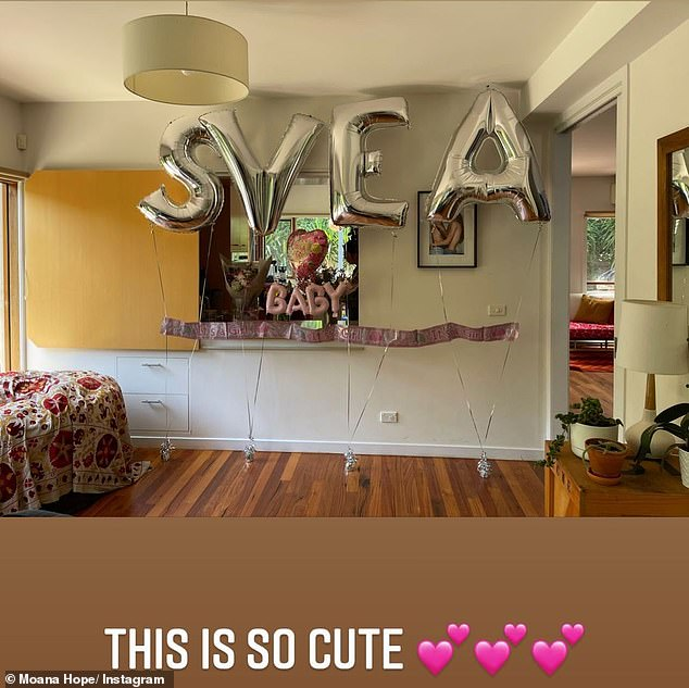 Sweet surprise: A second photo showed the couple's house decorated with balloons spelling out, 'Svea' and 'baby', to welcome the family home