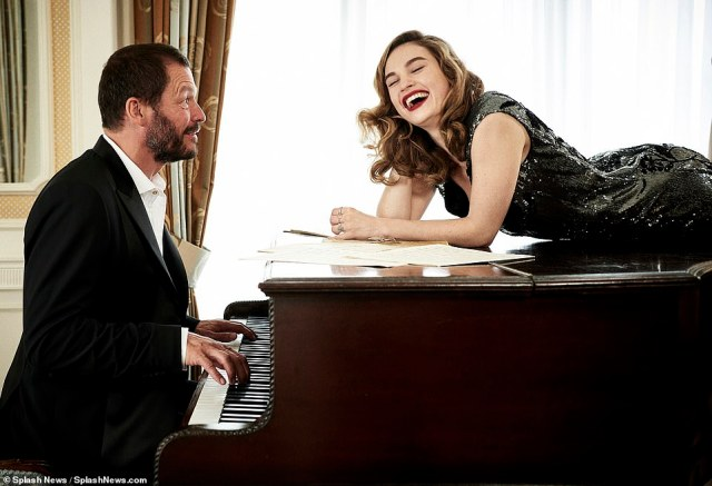 Lost in laughter: Lily couldn't hide her joy as she laughed while Dominic played the piano