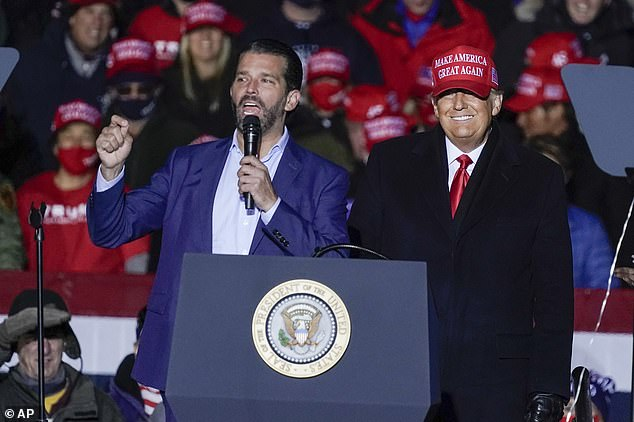 Several Secret Service agents tested positive after attending President Trump's final swing of campaign rallies - Don Jr is a regular speaker at his father's rallies; he's seen above at a rally in Kenosha the day before the election
