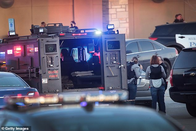 An estimated 75 officers were on the scene on Friday evening searching for the gunman