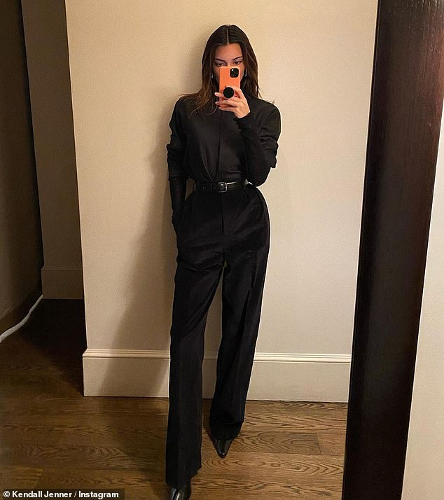 Stunning:The show stopping look consisted of a black mock neck blouse that Kendall belted at the waist and a pair of black velvet trousers