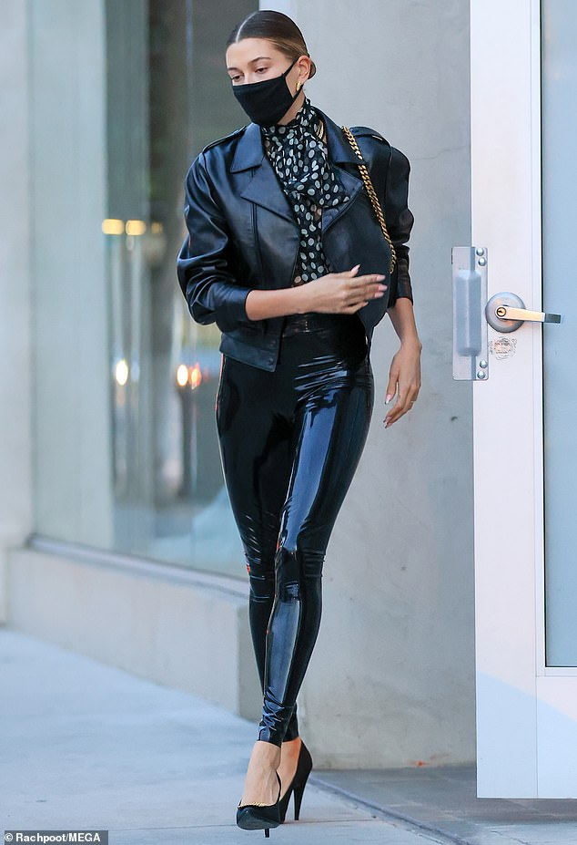 Leggy display: The 23-year-old showed off her toned stems in the high-waisted leggings, paired with a black crocodile belt
