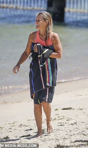 Stunner: The mum-of-three wore minimal make-up for the occasion, showing off her natural and age-defying visage as she enjoyed a leisurely afternoon in the sun