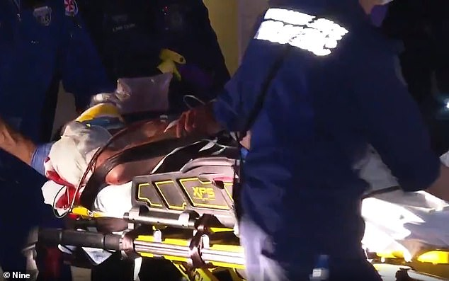 The 22-year-old was was treated at the scene before being carried out in a stretcher to St Vincent's Hospital in a serious condition