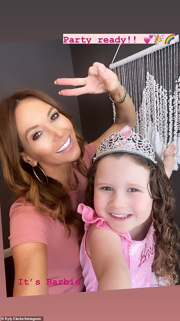 Bonding:Kelsey Lee dressed up in a Barbie-themed tutu and tiara, and posed for a number of photos with her mum
