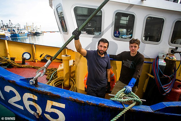 Last year the Joanna C, skippered by Nathan Clark, left, pictured beside crew mate Callum Clark, right, was surrounded by French trawlers off the coast of Normandy. The vessel suffered a broken window after French fishermen pelted it with objects