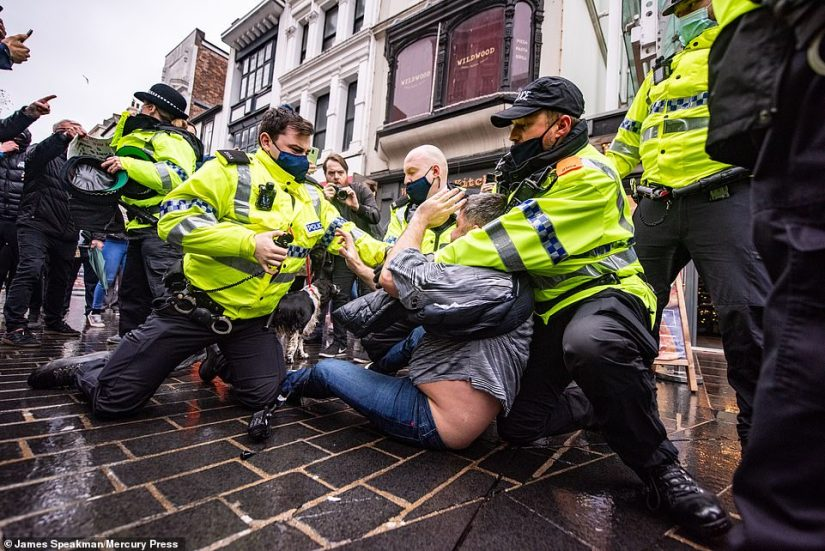 A man is arrested and pepper sprayed at a large anti lockdown protest in Liverpool today that saw hundreds march around the streets of the city