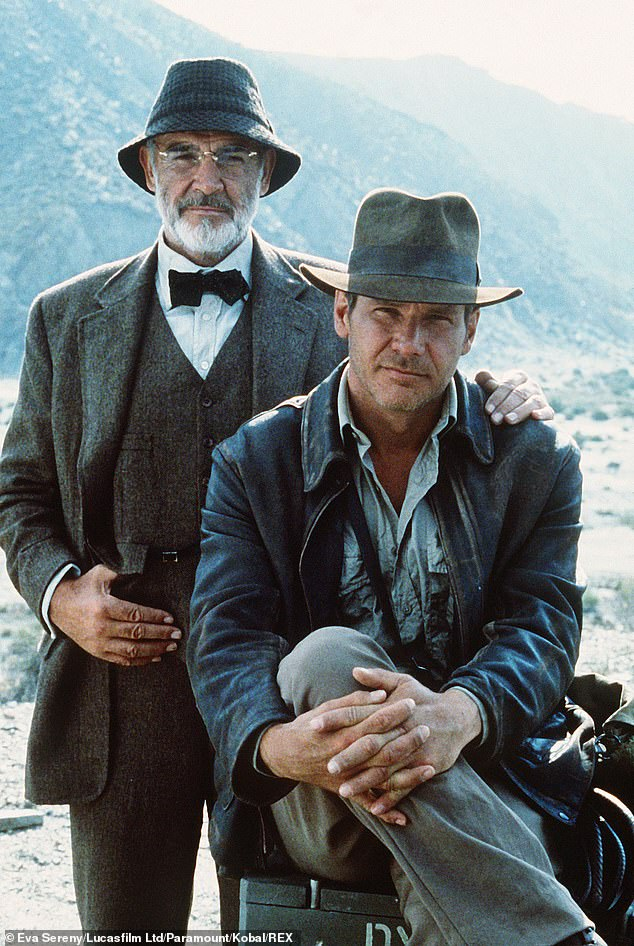 On-screen dad:Earlier this month, Ford paid tribute to his former costar and on-screen father Sean Connery, who died on October 31 at his home in the Bahamas; publicity still for Indiana Jones And The Last Crusade