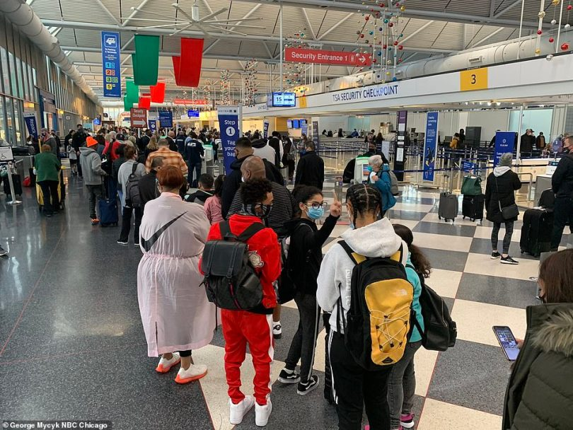 CHICAGO:Long lines of passengers were seen snaking around terminals at Chicago O'Hare International Airport on Friday with little social distancing practices observed