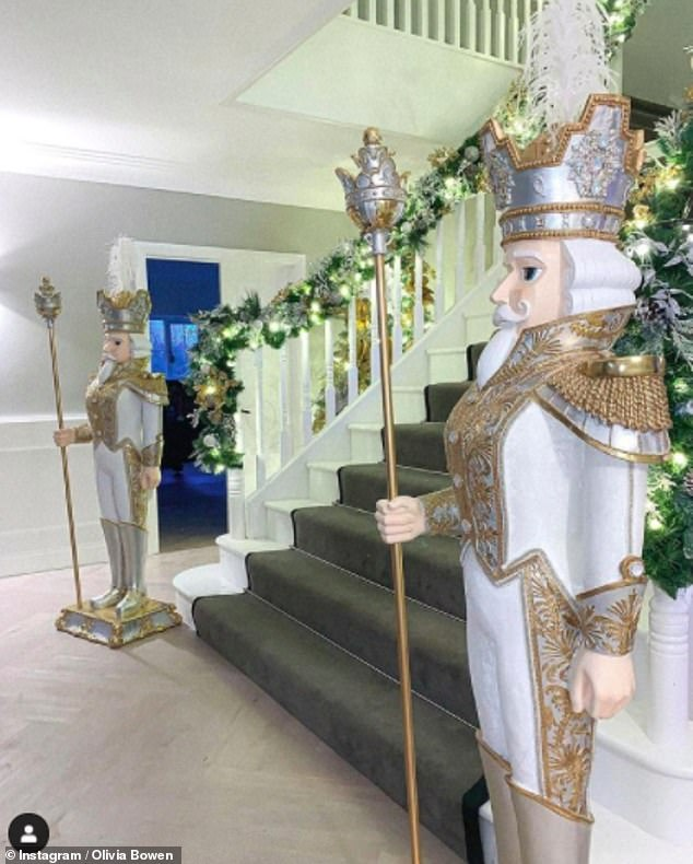 SO festive: The Love Island couple now have two life-sized white and gold nutcrackers in their incredible hallway as well as a twinkling garland wrapped around the staircase