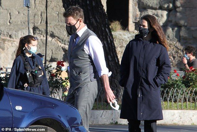Quick break: Tom appeared to be in good spirits as he worked on shooting more footage