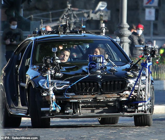 High tech: The car was covered with equipment and cameras for the shoot