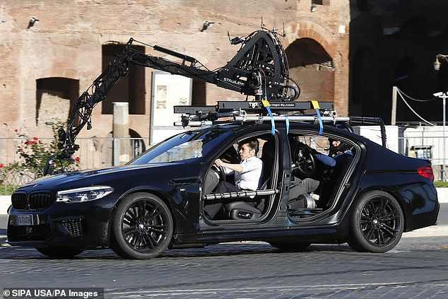 In control: A stunt driver was seen controlling the car from the back seat