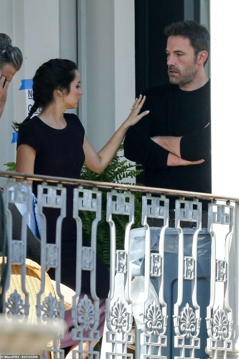 Love is in the air: Affleck, 48, put on an animated display while on a balcony in The Big Easy as Ana, 32, showed of a sparkling diamond ring on her left hand