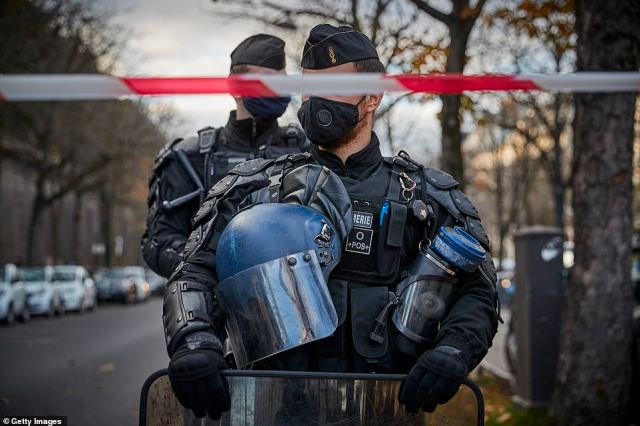 French Riot Police watch demonstrations against the French Government's Global Security law bill which makes it illegal to disseminate images that identify police