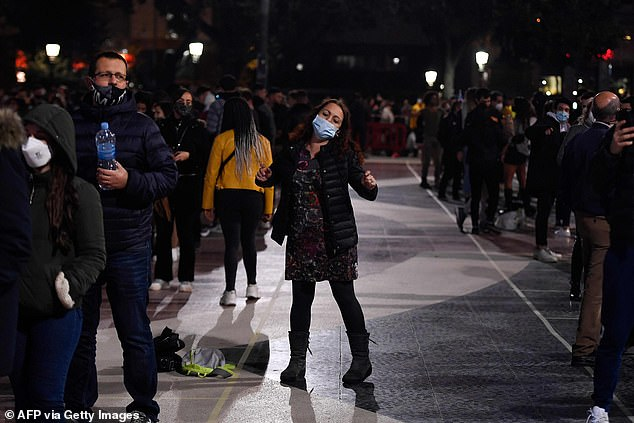 Cinemas, theatres and concert halls will also be able to reopen, but with a capacity of 50 per cent, from Monday.Pictured: Revellers on the streets of Barcelona tonight