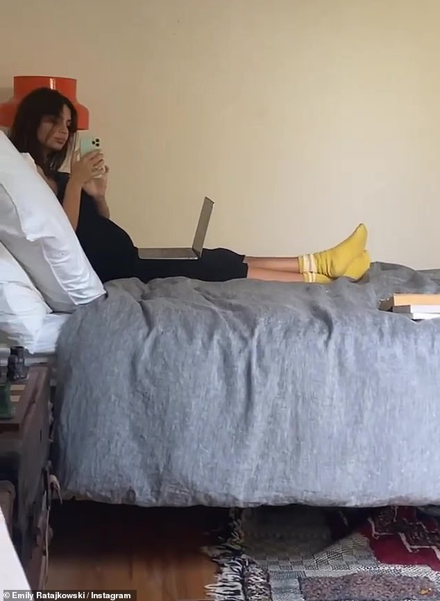 Writer's block: With her belly slightly obstructing her view of the screen Emily zoomed in on her body