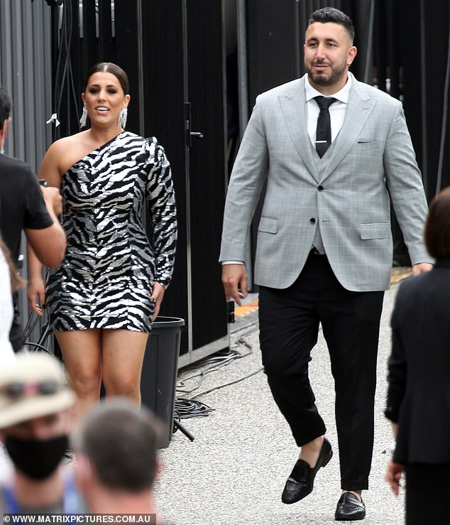 Chic: Sarah (left) wore a silver-and-black tiger-print dress with single sleeve detailing and large dangle earrings