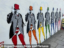 A mural of Winston Churchill wearing stockings and suspenders and giving the V sign (pictured) has attracted complaints from locals who claim the hand gesture is 'offensive'