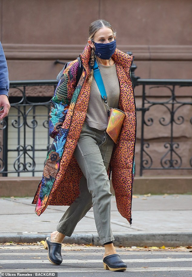 Winter fashions: The Sex And The City actress once again donned her FARM Rio Jungle Pop puffer coat for the late fall outing, the same winter coat she was seen in earlier this week