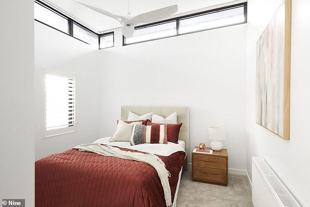 Sleek: Another bedroom features a rust colour interior